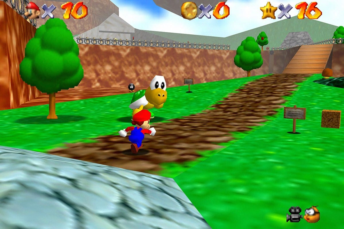 Mario in the first level of the game, running down a path with a Koopa next to him.