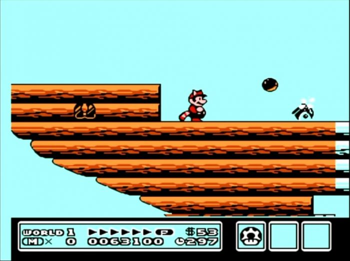 Raccoon Mario stands on an air ship while a cannon fires at him.