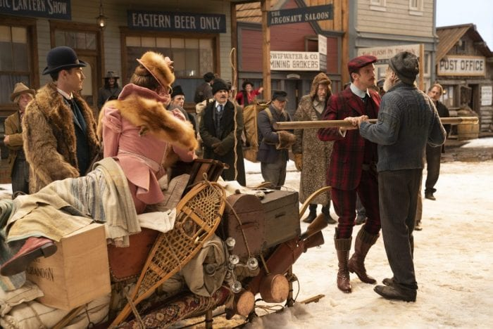 Hal confronts John Thornton on the busy street by the dogsled