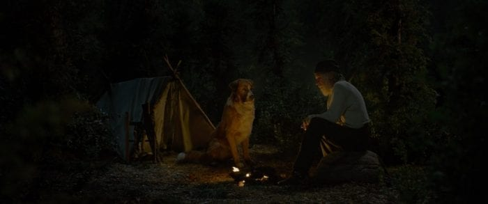 Buck and John Thornton share a campfire tale.
