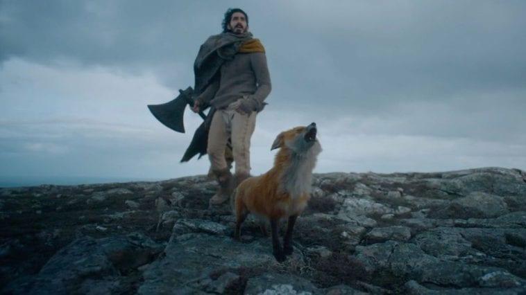 Sir Gawain and his fox walk on a rocky surface