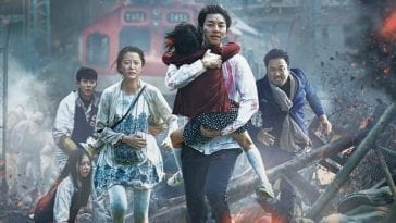 the main characters of the movie running away from the train and zombies, with wreckage all around them
