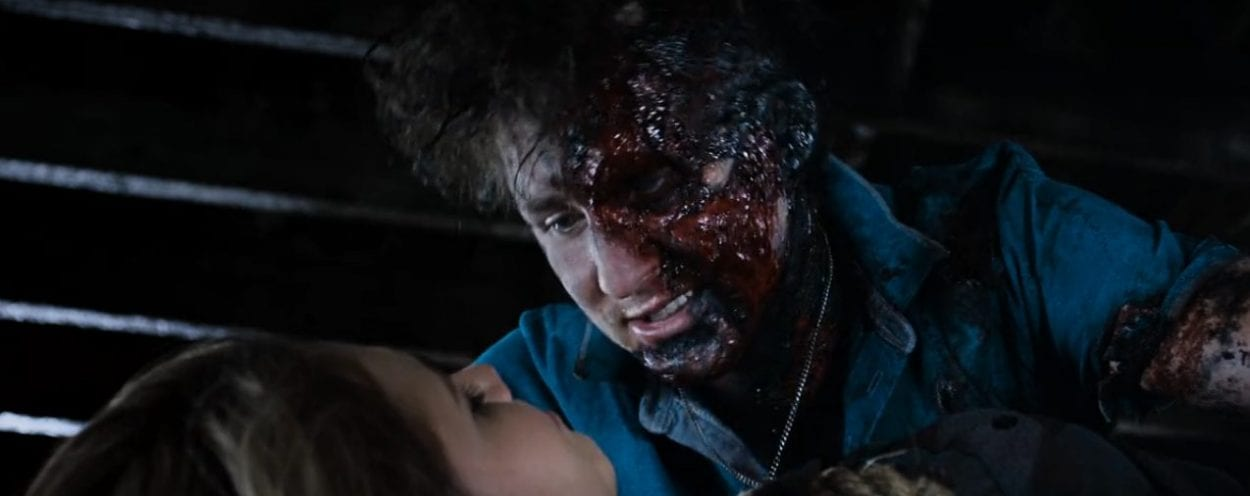 A bloody Chad leans over Allison
