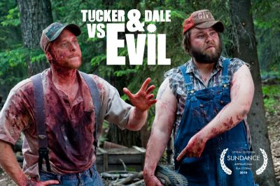 Tucker and Dale standig side by side covered in blood with confused looks on their faces