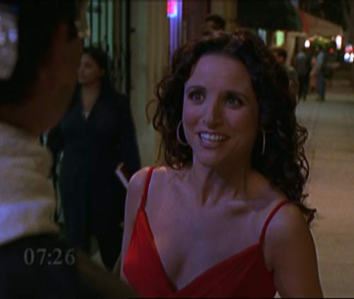 Julia Louis-Dreyfus in the pilot of Watching Ellie with the clock on the screen