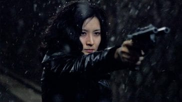 Geum-ja points her custom gun n the snow
