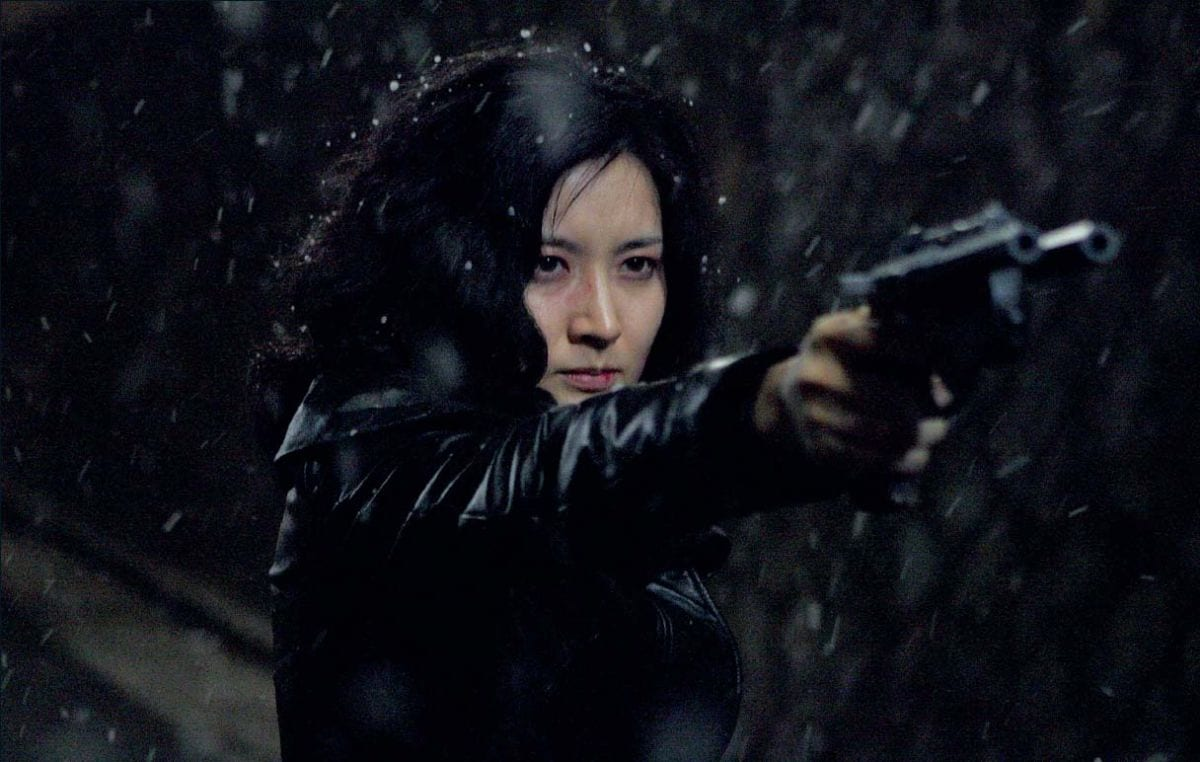 Geum-ja points her custom gun n the snow