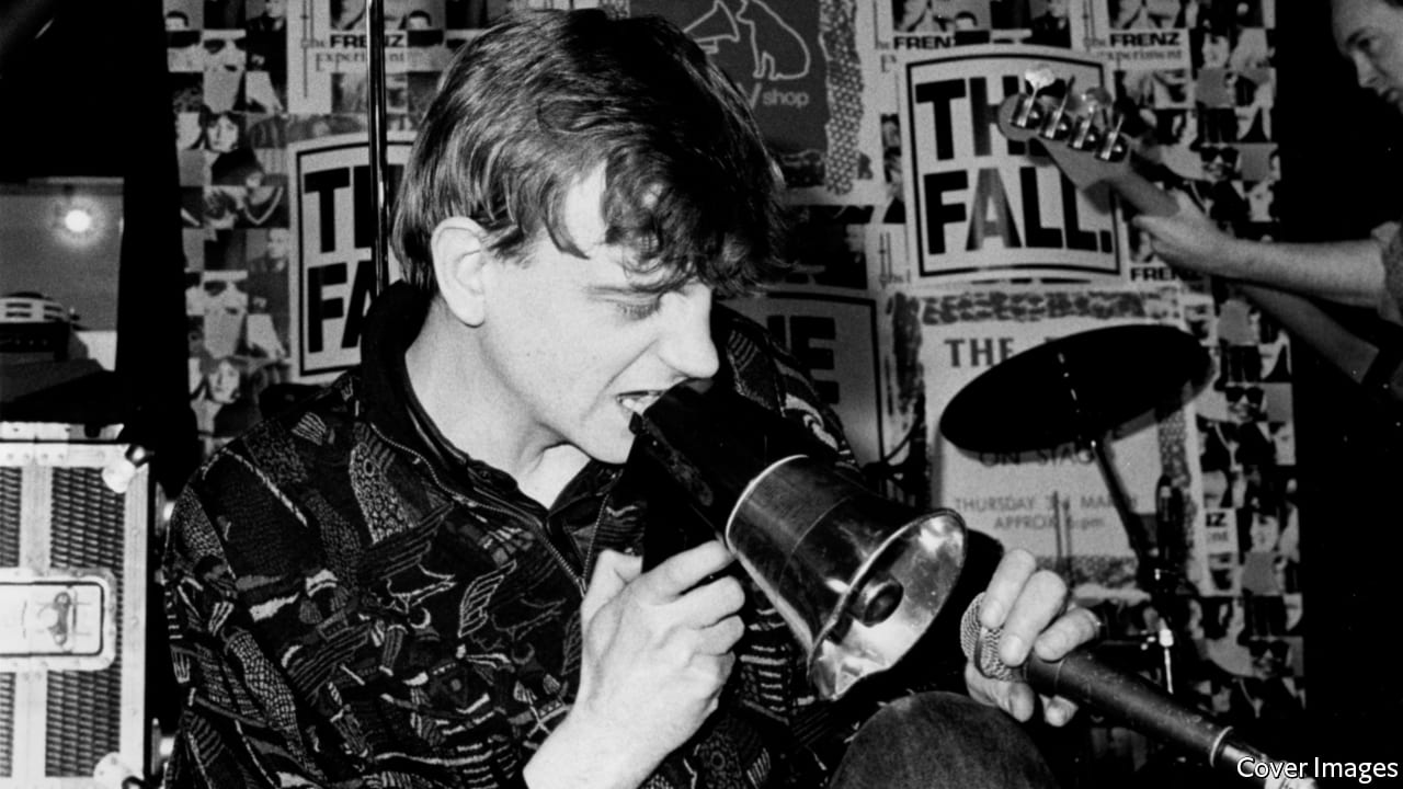 Mark E. Smith on stage, ranting into a megaphone