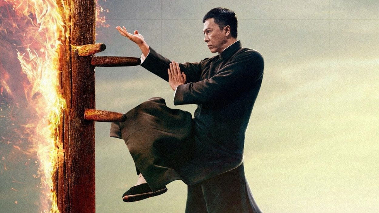 Donnie Yen spars with a flaming wooden dummy