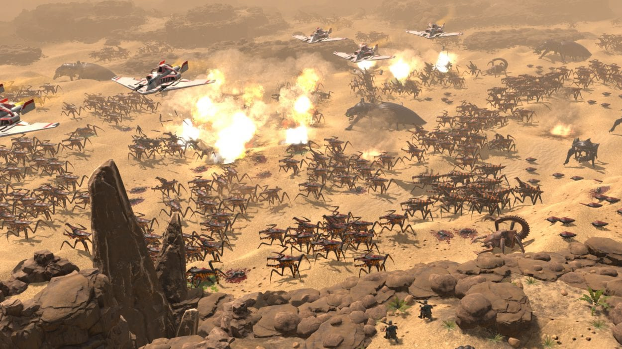 A large battle on an alien world, fighter planes fly above and bomb the insect hordes down below in Starship Troopers