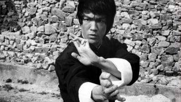 Bruce Lee strikes a pose on the set of Enter the Dragon