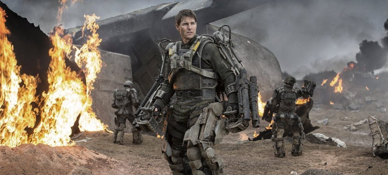 Cage standing in front of a cargo plane that is on fire in Edge of Tomorrow
