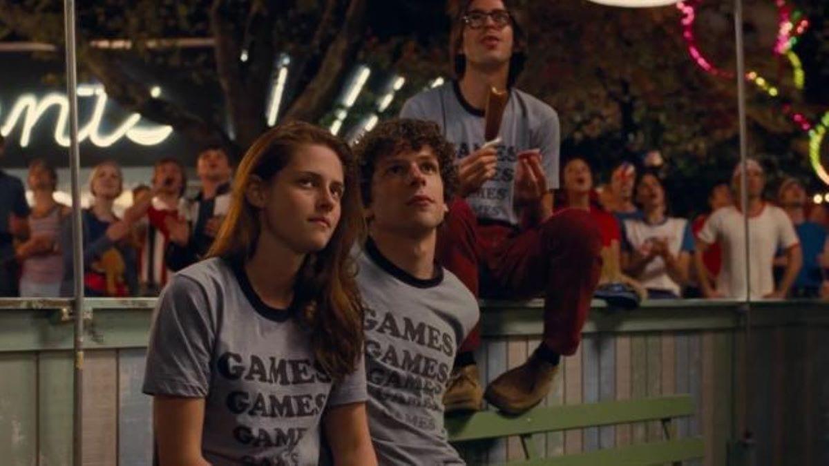 Three employees of Adventureland watch a firework display