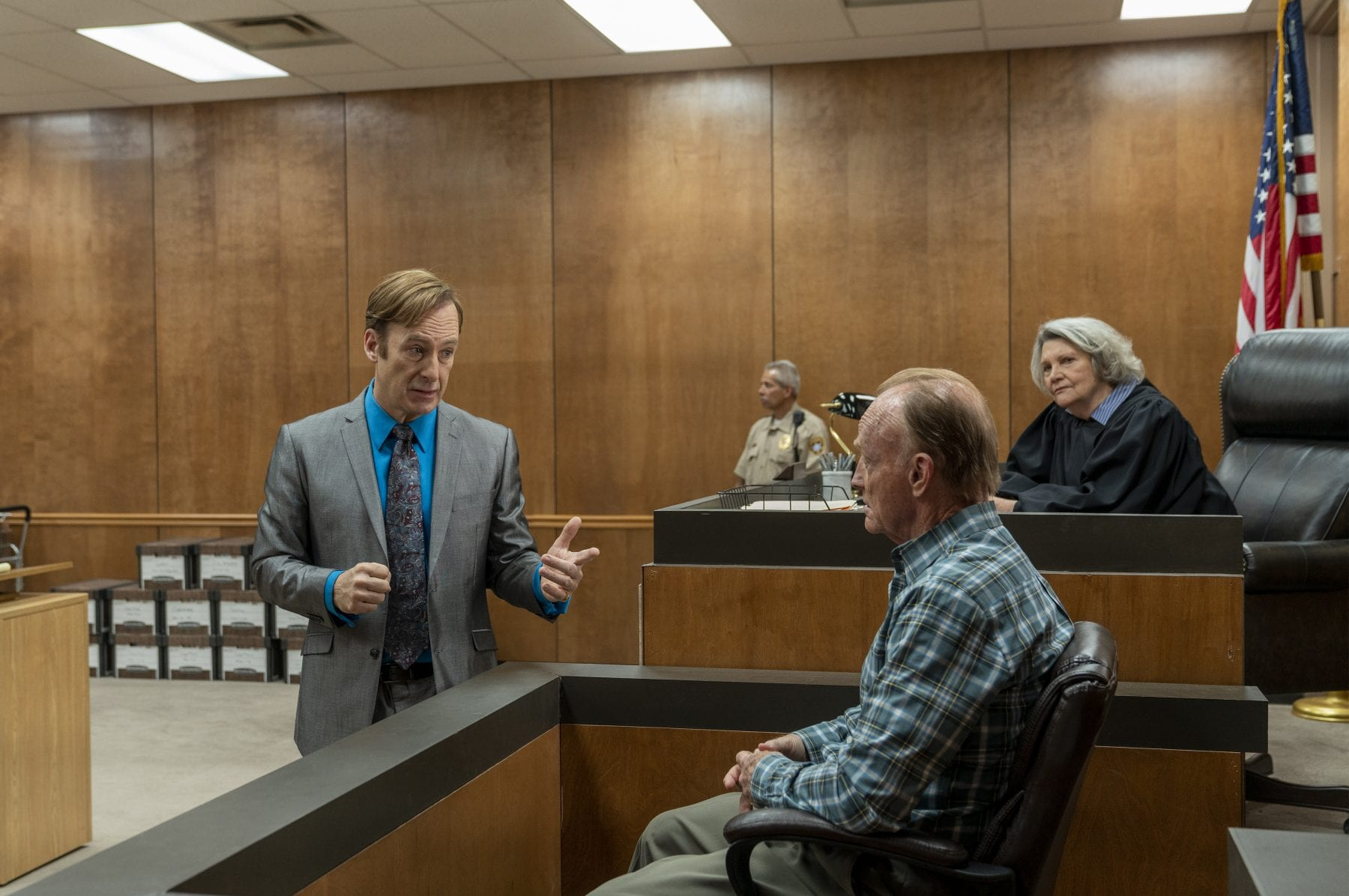 Jimmy questions a witness in the courtroom as the judge looks on