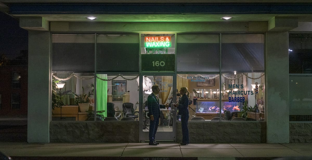 A wide shot of Jimmy and Kim standing outside the nail salon