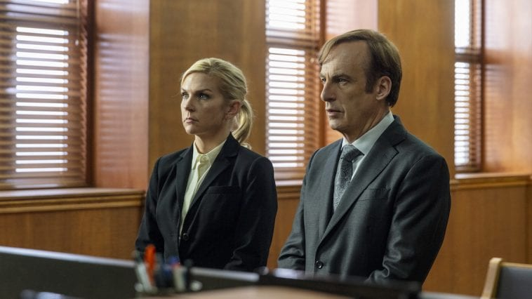 Jimmy and Kim stand next to each other in court facing the justice of the peace