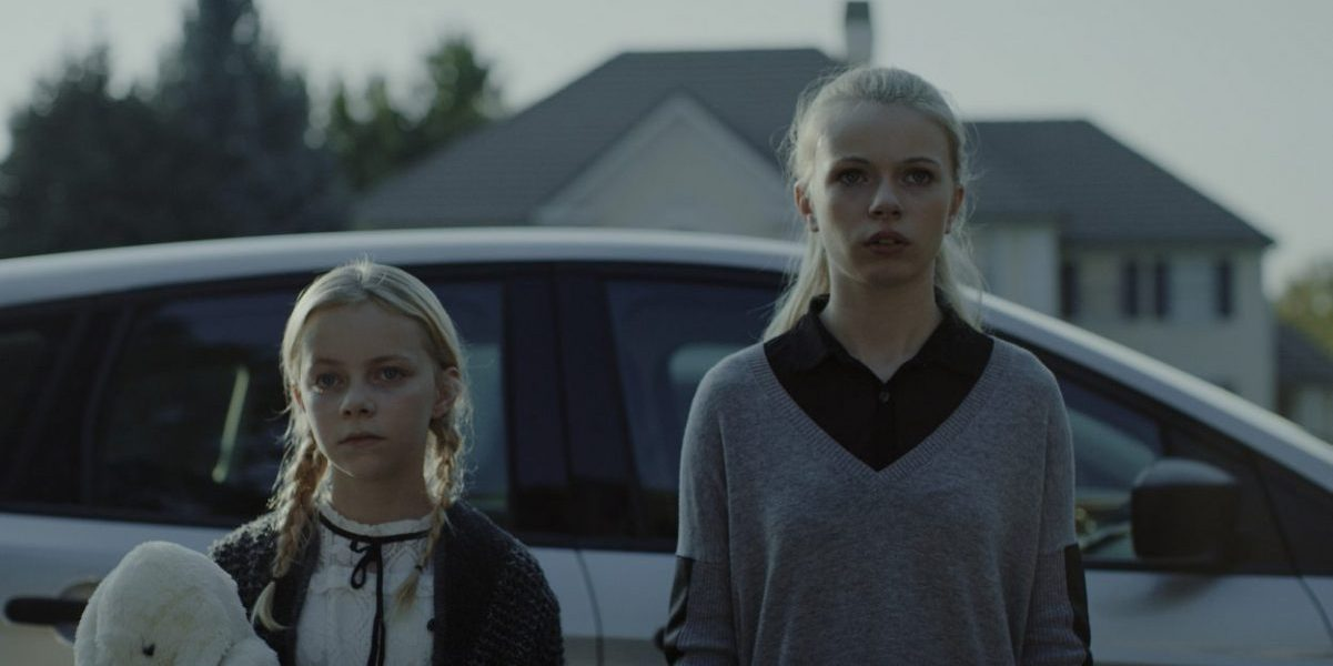 Claire and Olivia stand outside their aunt's house.