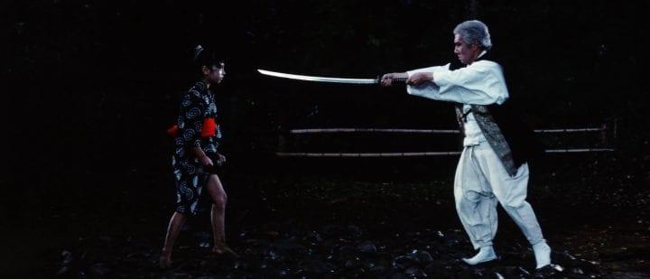 Yuki's teacher points a sword towards her face