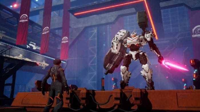 A pilot stands in front of his mech, which has a cannon on one arm and a pink laser sword in the other.