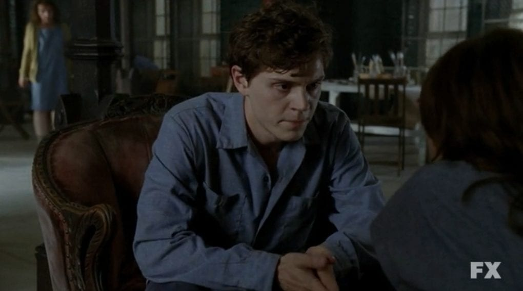 Inmate Kit Walker, seated in the common room of the asylum