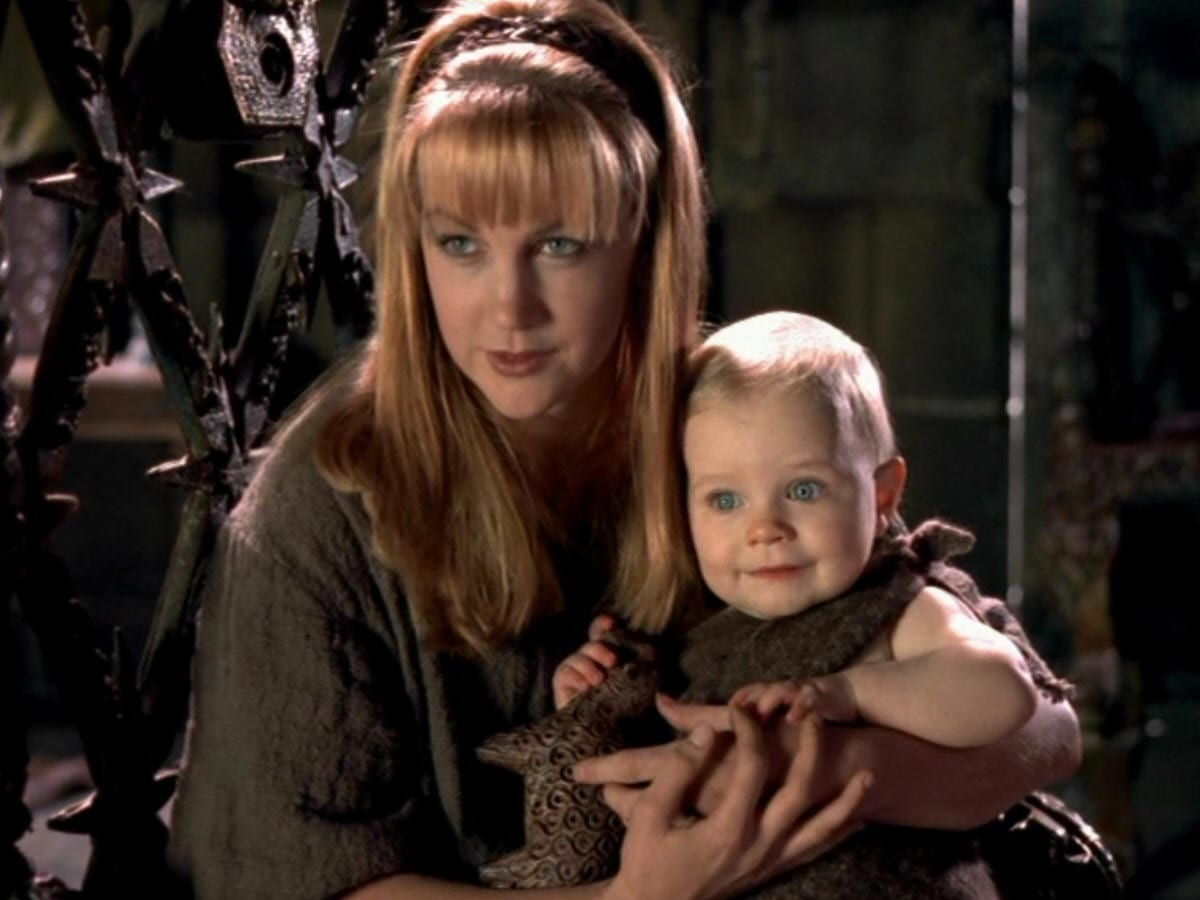 Gabrielle holds her blond baby daughter, Hope