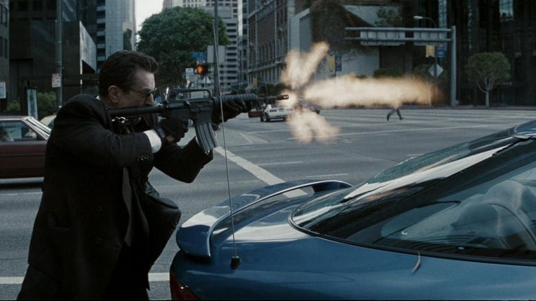 Neil fires a high-powered machine gun at a collection of cops