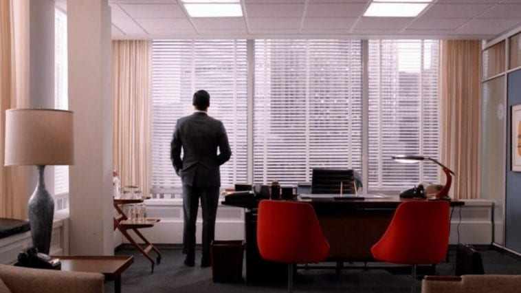 Don Draper stares out his office window