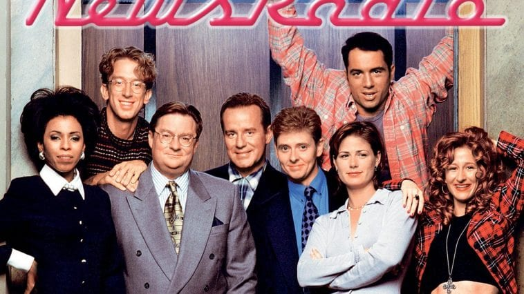 The cast of NewsRadio standing in front of the elevator on the set of series.
