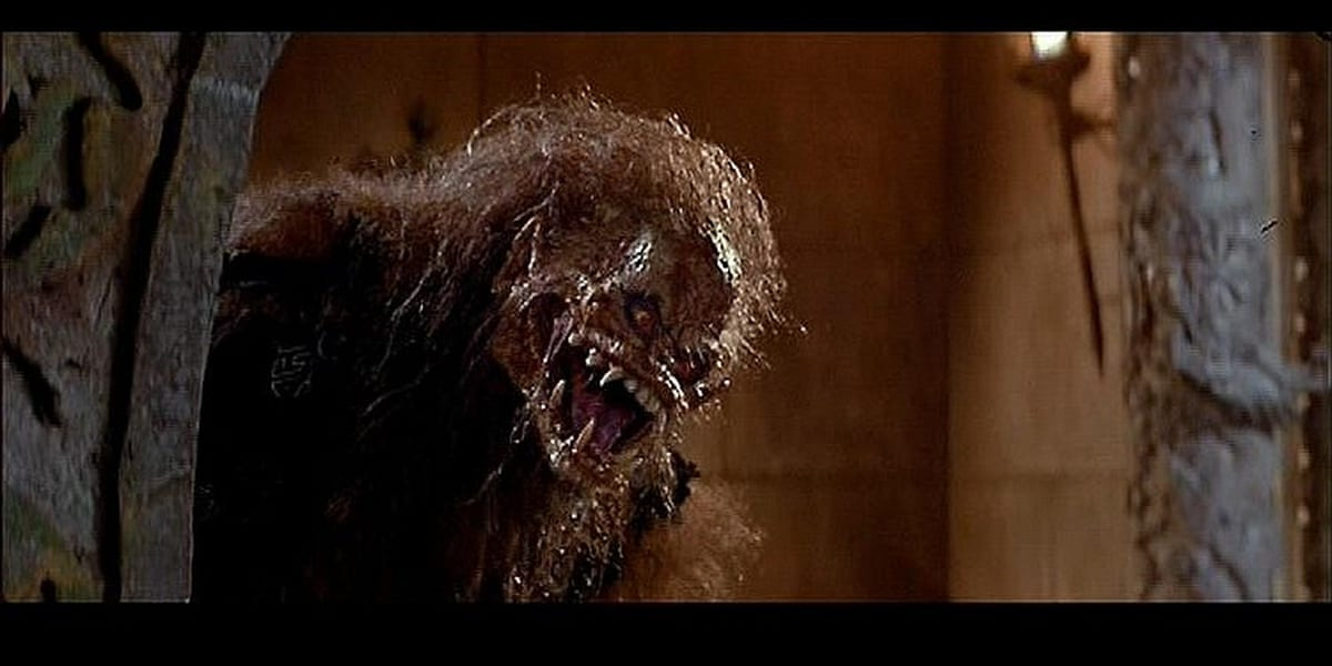 The orangutan creature in Big Trouble in Little China lurking around a corner staring to the right with its mouth open