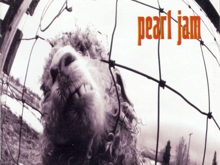 "A black and white image of a sheep's head behind a fence. ""Pearl Jam"" is in red."