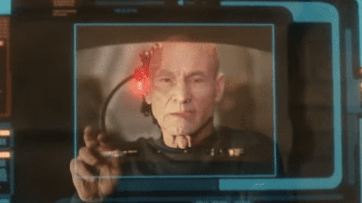 Picard S1E6 - Picard looks through a holo-image of himself as Locutus of Borg, superimpossed perfectly over his face