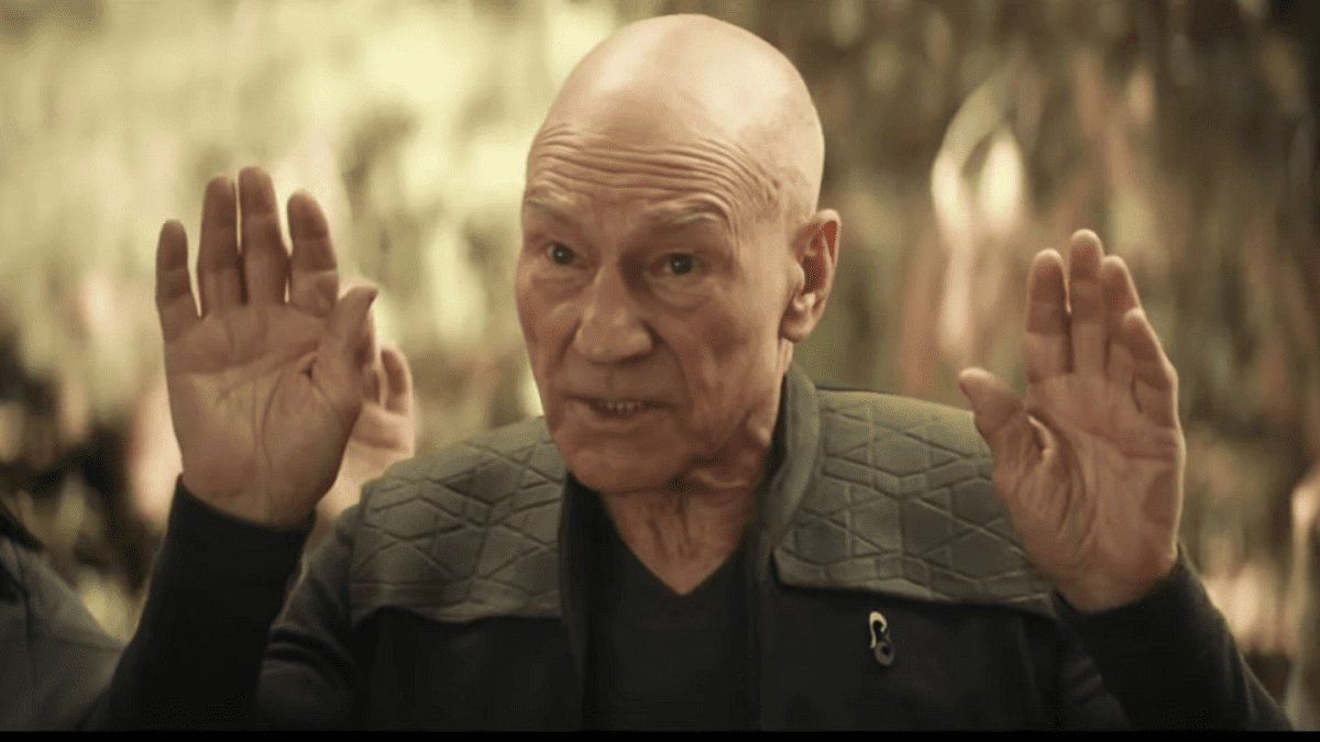 Picard with hands up in a gesture of surrender