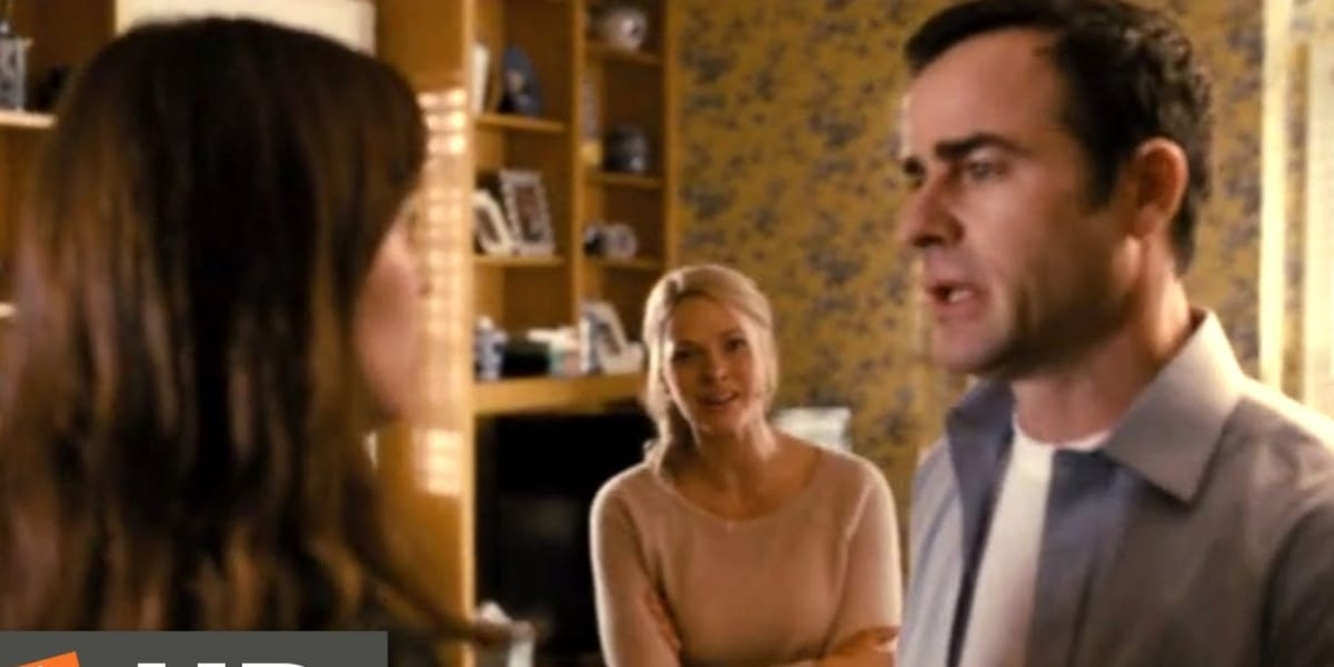 Rachel facing a rattled-looking Tom with an insistent and intense-looking Anna in the background in The Girl on the Train