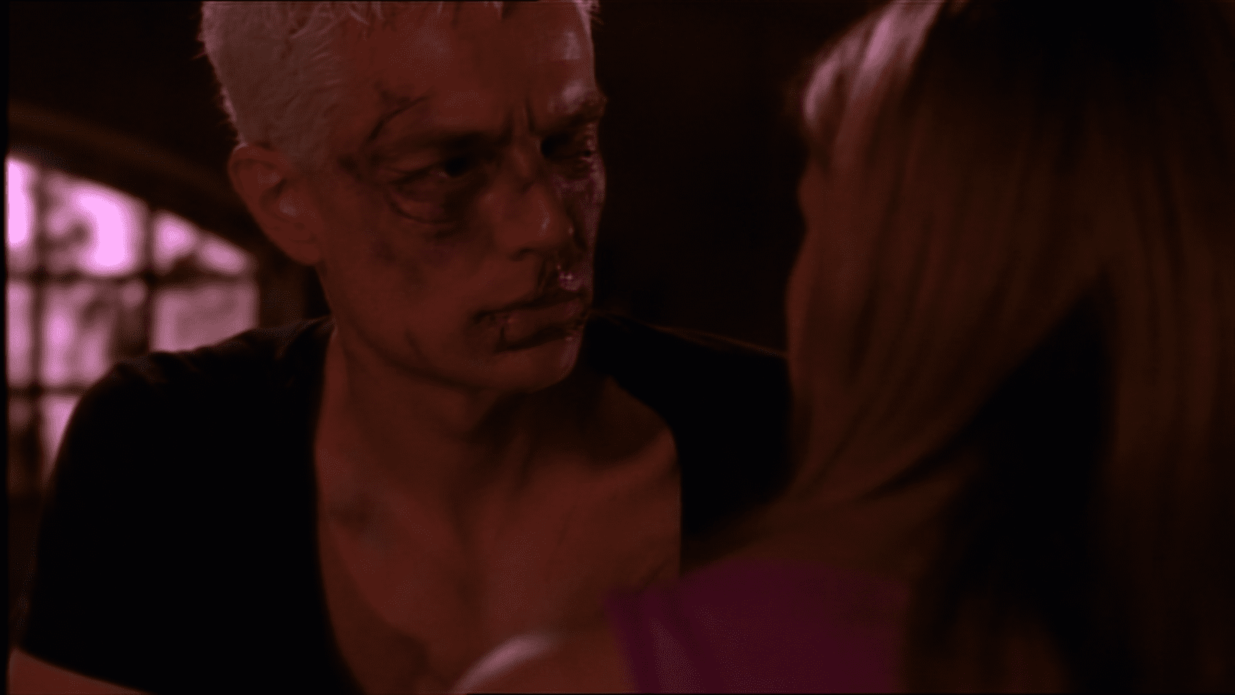 A beaten up Spike looks at Buffy