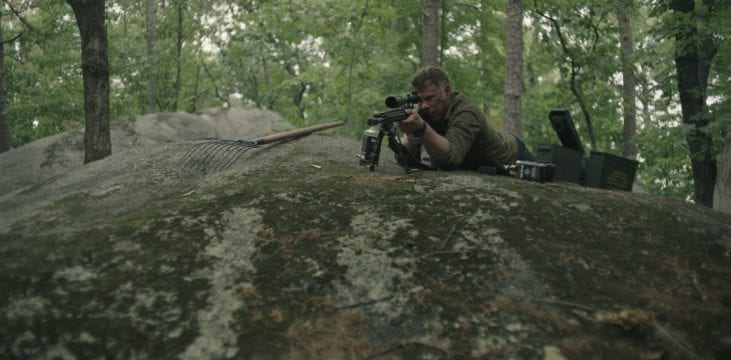 Jack in sniper position surrounded by ammo
