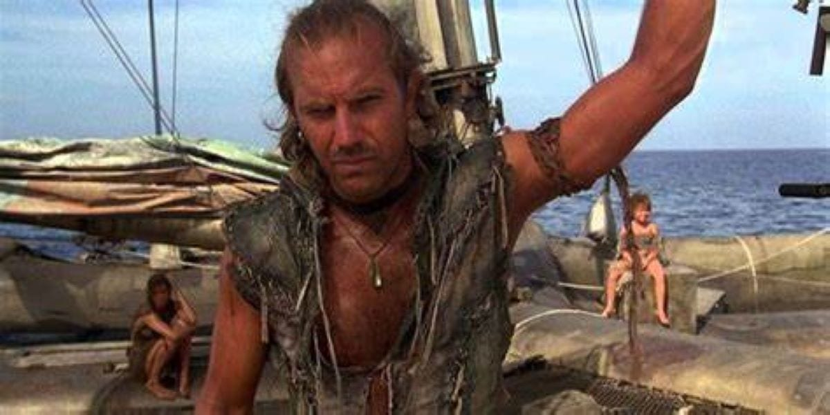Kevin Costner as the Mariner on his boat on endless sea in Waterworld