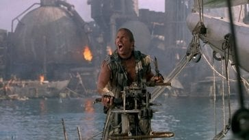 Kevin Costner as the Mariner amongst the burning atoll set of Waterworld