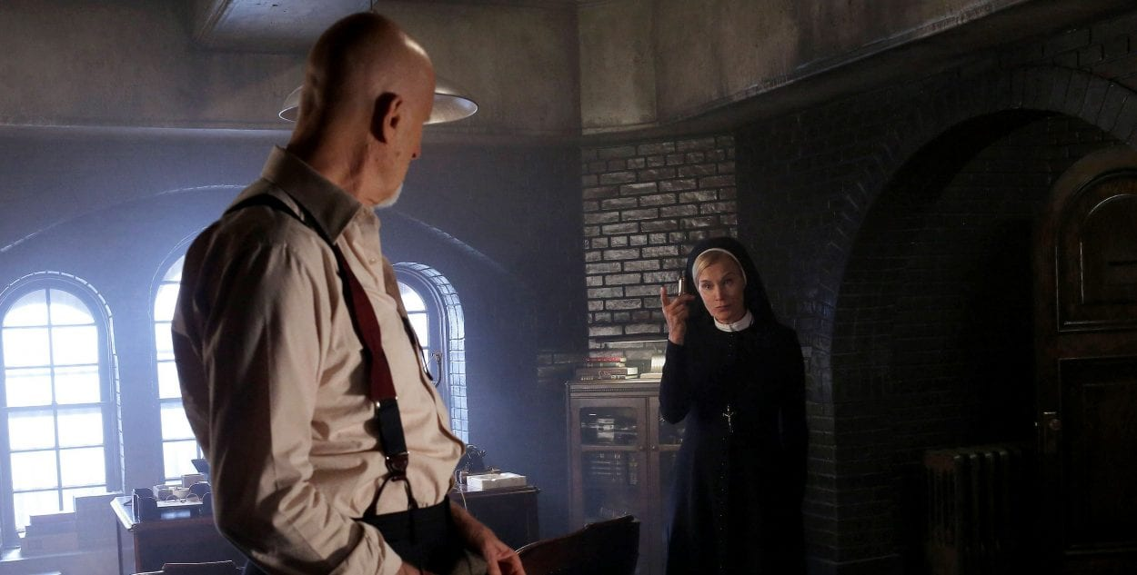 Dr Arden and Sister Jude, in Arden's laboratory