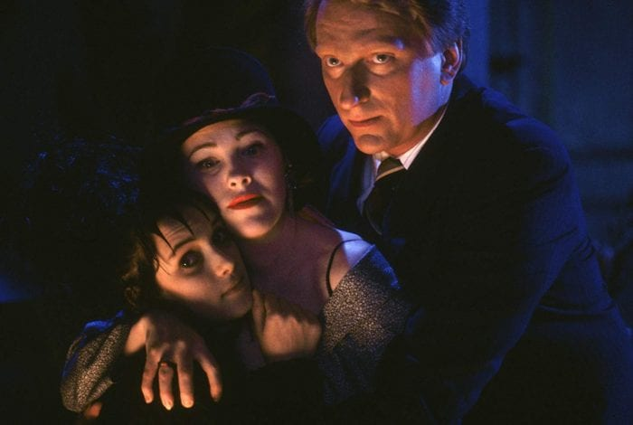 The Deetz family hug in Beetlejuice.