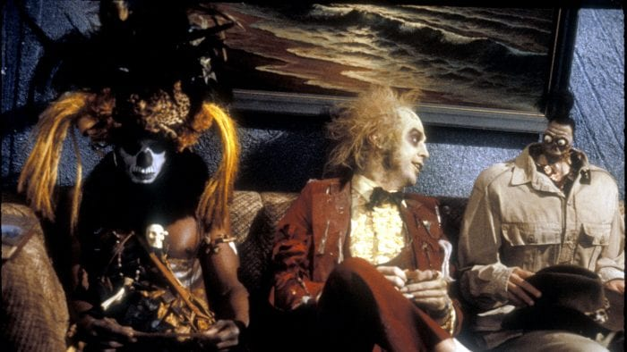 Betelgeuse sits in the waiting room with a Voodoo Warrior and a man with a shrunken head.
