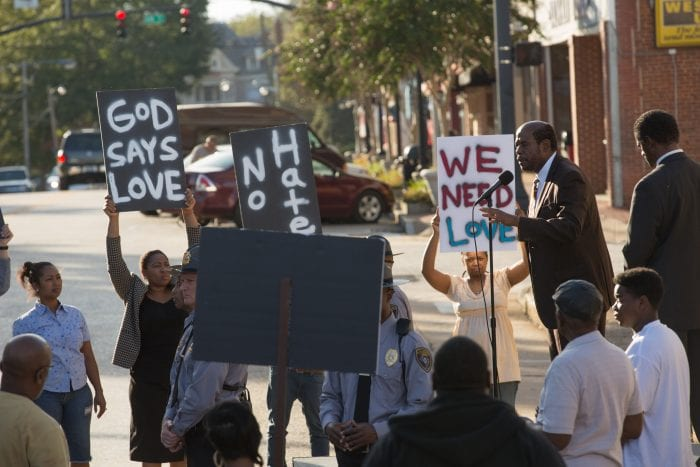 Black protesters flaunt signs of love in the street