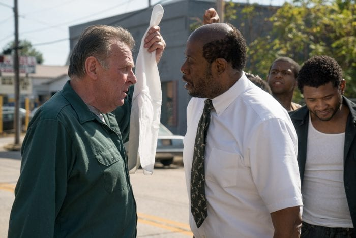 KKK leader Tom Griffin and church leader Rev. David Kennedy clash in a street protest