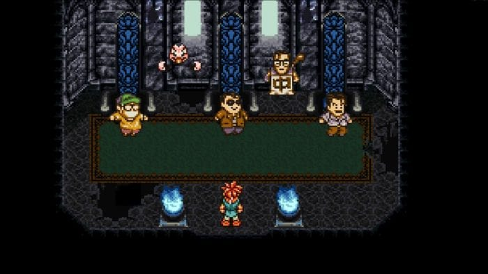 Crono stands in one of the developer rooms, where in game sprites of Yuji Hori, Akira Toriyama, and Hironobu Sakaguchi talk to him.