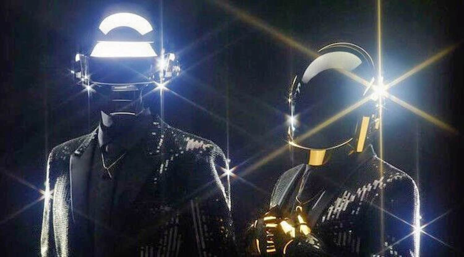 the duo of Daft Punk standing in their chrome helmets, shining very brightly
