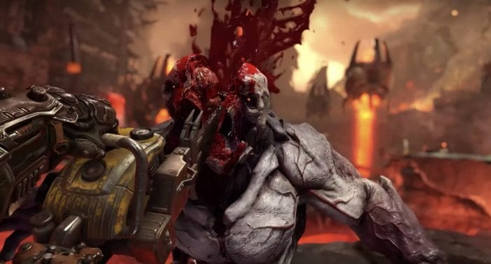 The Doom Slayer cuts a demon down the middle with a chainsaw. This is awesome.
