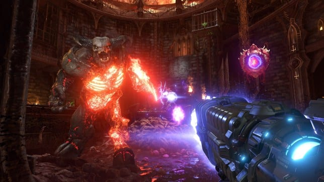 The Doom Slayer blasts away at a tall horned demon with the Plasma Rifle