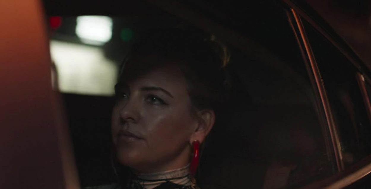Lainey as seen through the backseat window of a car in High Maintenance S4E6