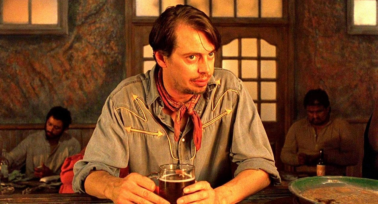 "Buscemi leans in to tell a story to a bartender in ""Desperado"""
