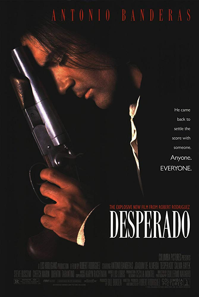"Antonio Banderas in profile resting the barrel of a gun on his forehead in theatrical poster of ""Desperado"""