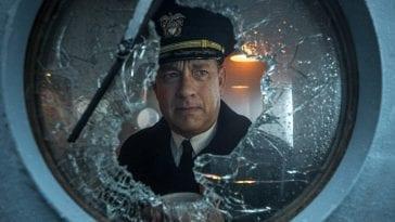Tom Hanks looks out a damaged porthole on a battleship